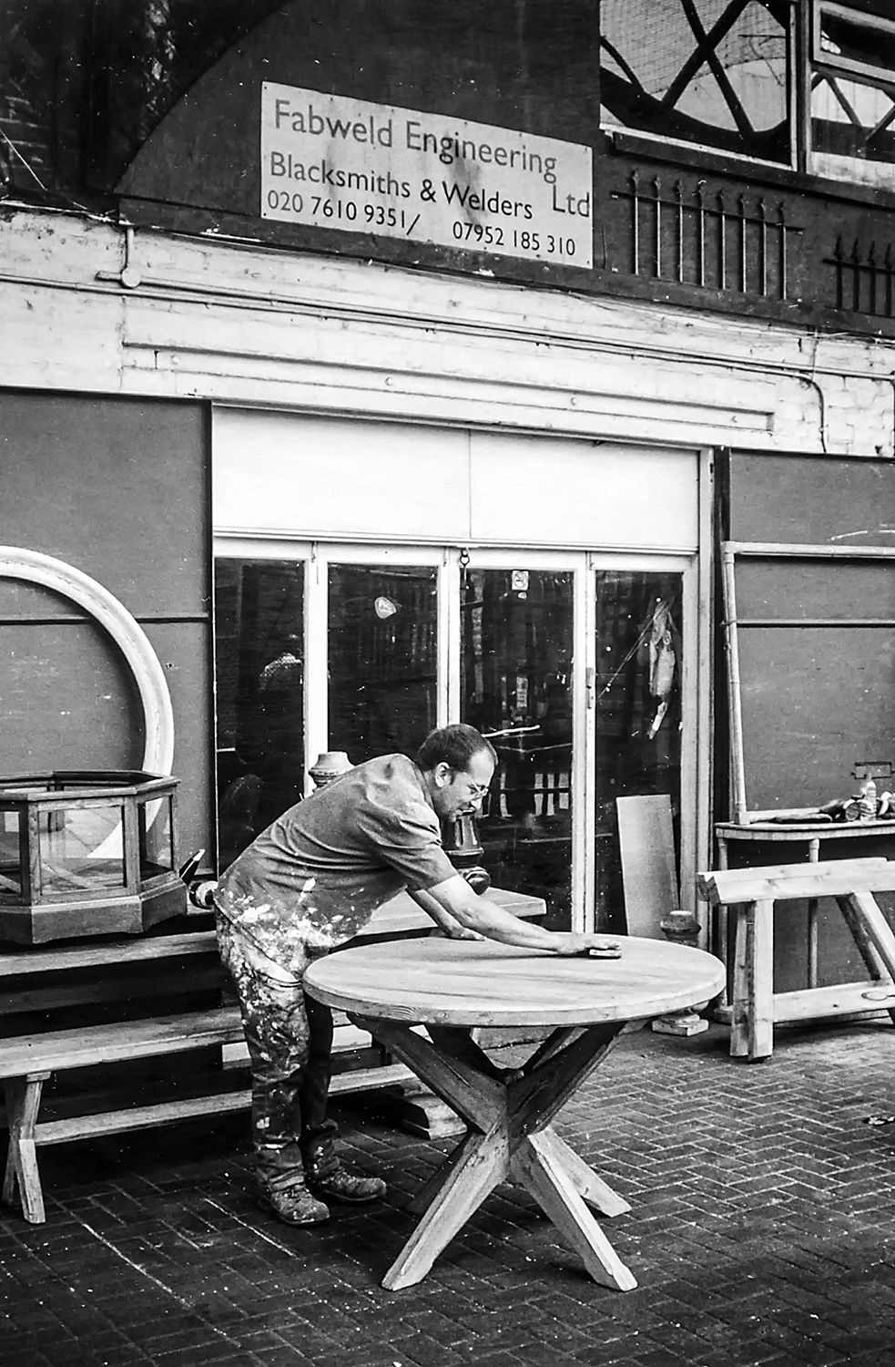 David sanding at Fabweld Engineering  The Arches Putney Bridge Station Approach, SW6