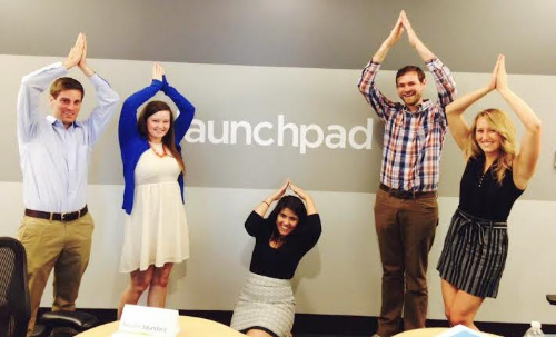 The Launchpad team pretending to be rockets after our first day in the office (not pictured: Lindsey Wolfgang).