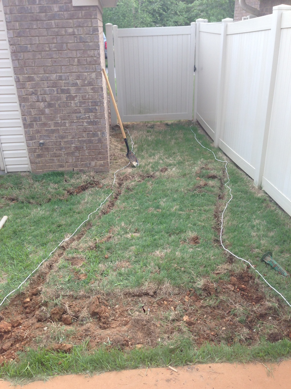Rope laid out as a guide and shallow trench dug where rope was placed.