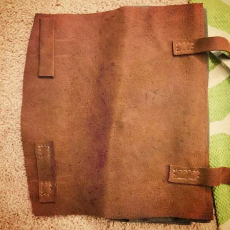 Sewing the straps and the strap holders on the leather flap.