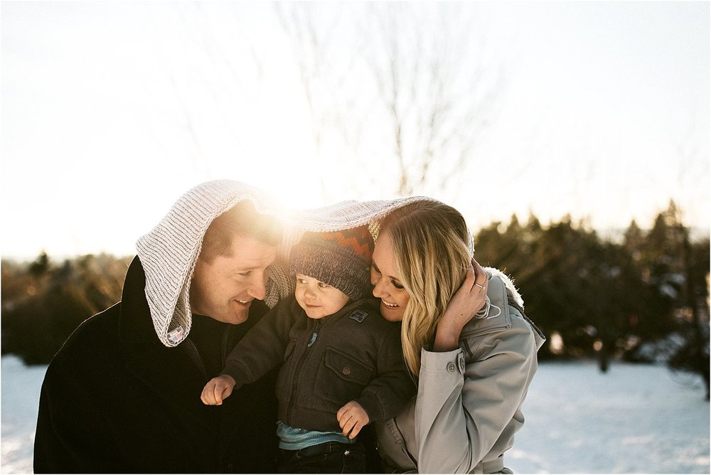 family wrapped in blanket photo session