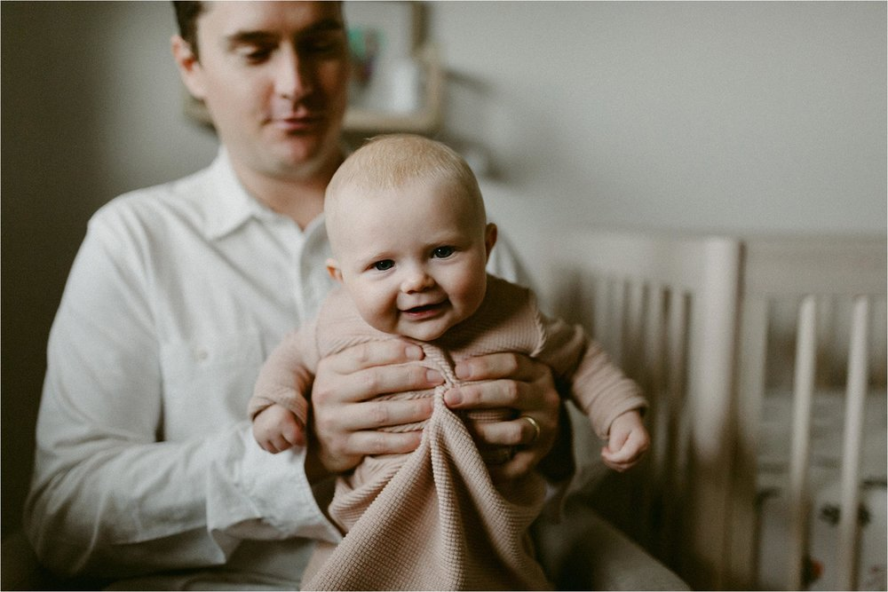 Smiling baby with dad