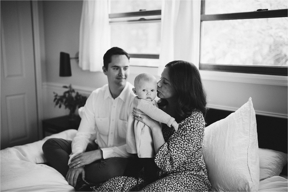 Family on the bed for in-home photo session
