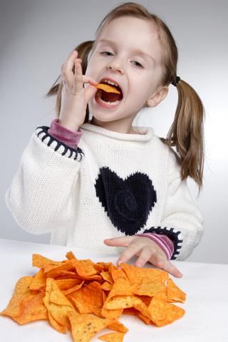 girl eating doritos
