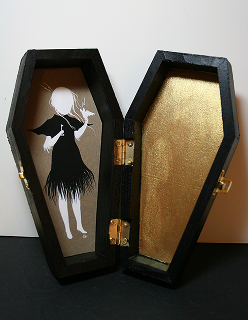 Waking Up - gouache on paper, mounted inside of a black & gold painted coffin.