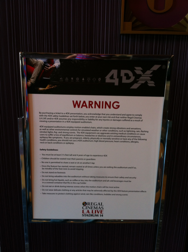 "I snapped this picture of the ""Warning"" signage outside the 4DX theater upon exiting."