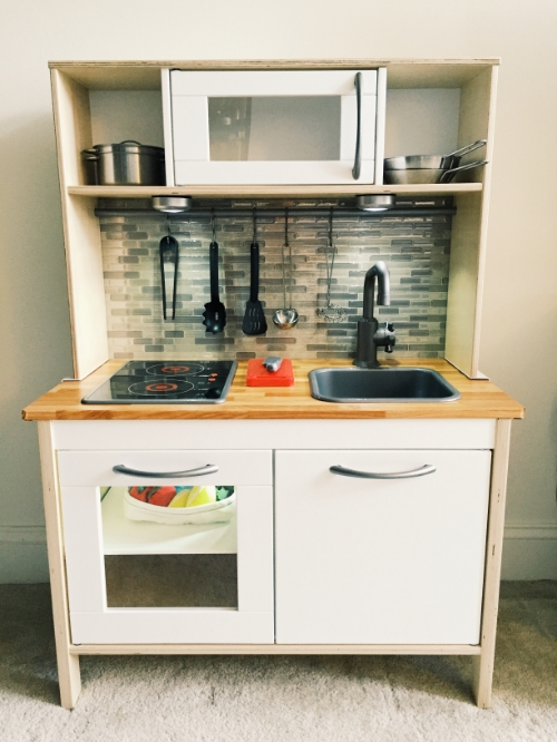 We made this Ikea play kitchen with Pinterest upgrades for our son's second birthday.