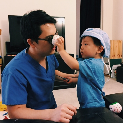 Getting some early instruction on being an ophthalmologist, just like daddy.