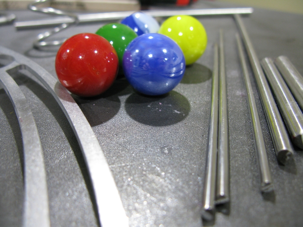 Start with stainless steel rod, colorful glass marbles, imagination, and add a dollop of effort.