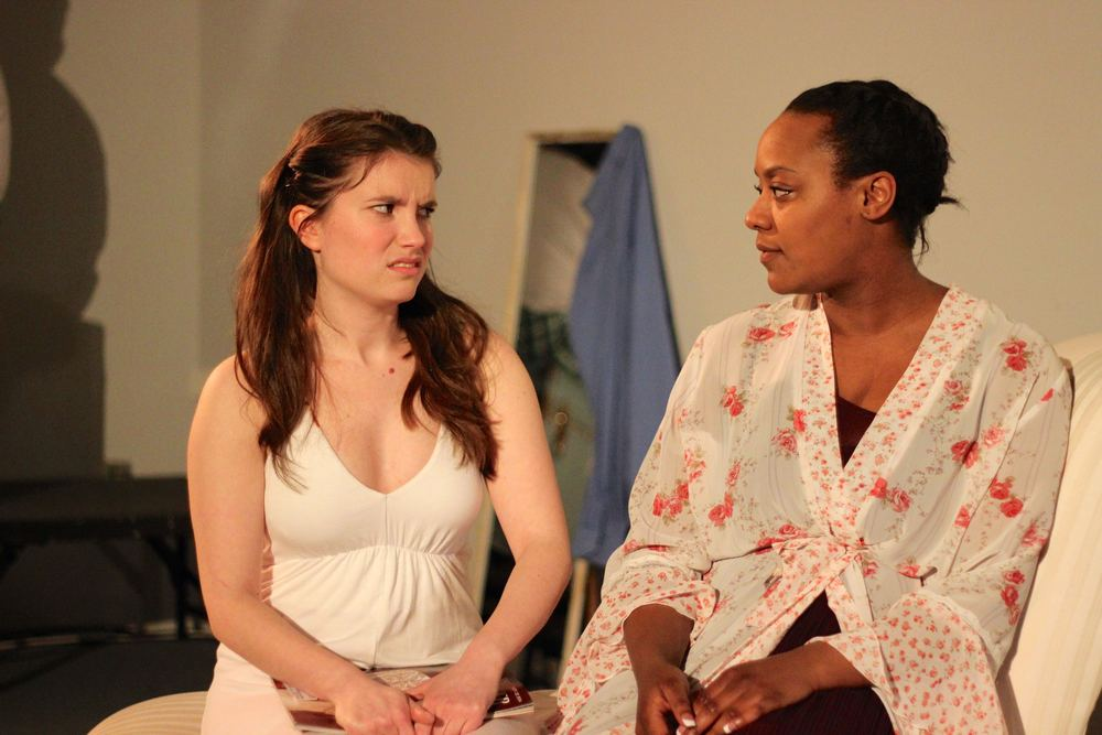 Melody Martin as Iphigenia and Jade Guerra as Clytemnestra