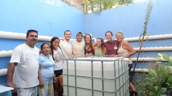 The complete system at Genaro Estrada - Just waiting on the fish and plants - We'll come back on Saturday to finish.  Left to Right: Alejandro and his wife Laura, From Washington are Alicia and Kyle Brose, from Tijuana YWAM are Mauricio, Rachel, Allie and Jackie - then Me!