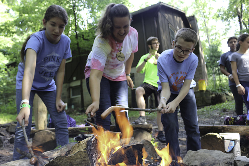 Many campers enjoyed hot dogs over the fire this summer.