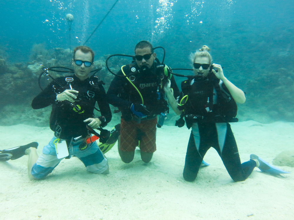 At the beginning of our dive, clowning around at Bikini Bottom; Roatán, Honduras.
