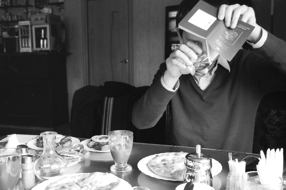 Russian Far East. Arista 400. Dmitry dips his new passport in vodka, a tradition for important documents.