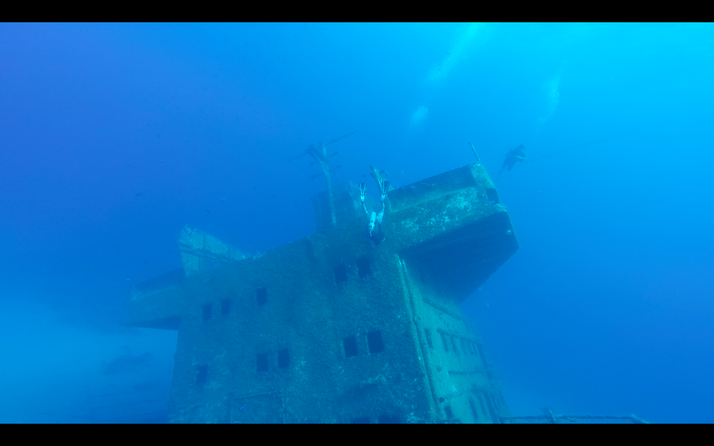 That's me hanging upside-down, exploring marine life on the wreck.