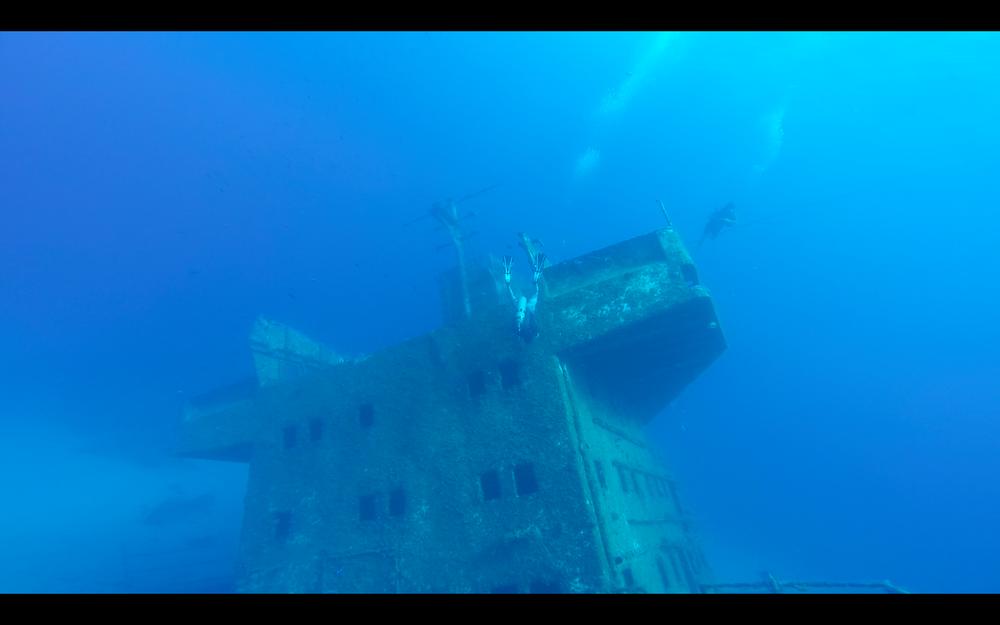 That's me hanging upside-down, exploringmarine life on the wreck.