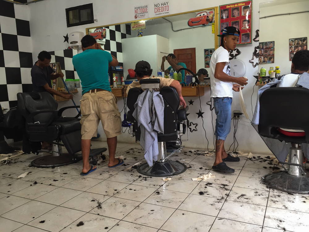Coxen Hole barbershop, 70 lempiras ($3.18) for a haircut and another 30($1.37) for a shave.