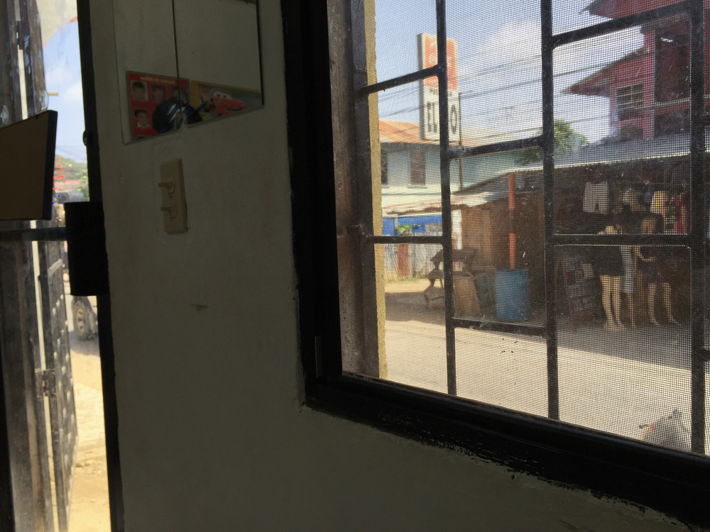 The view from the barbershop out toward the street; Coxen Hole, Roatán.