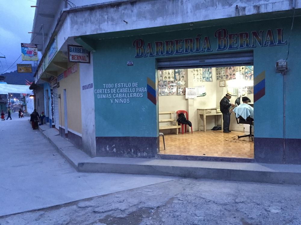 Nebaj, Guatemala. Typical barbershop, typical street corner.