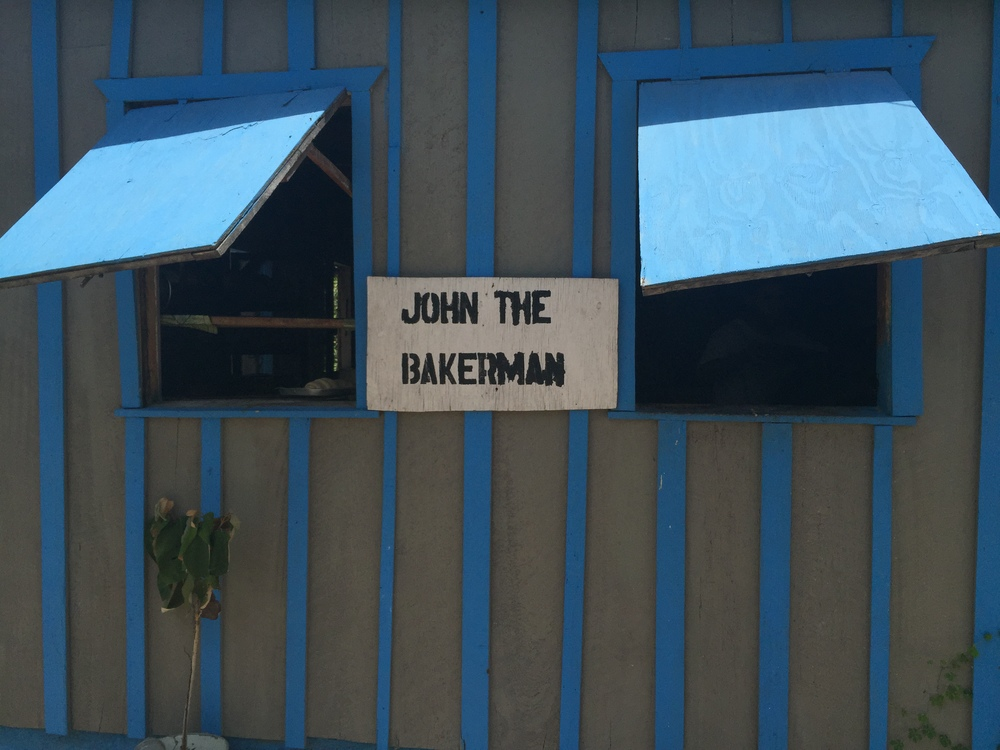 John the Bakerman will bake you some cinnamon rolls, or coconut bread. Placencia, Belize.