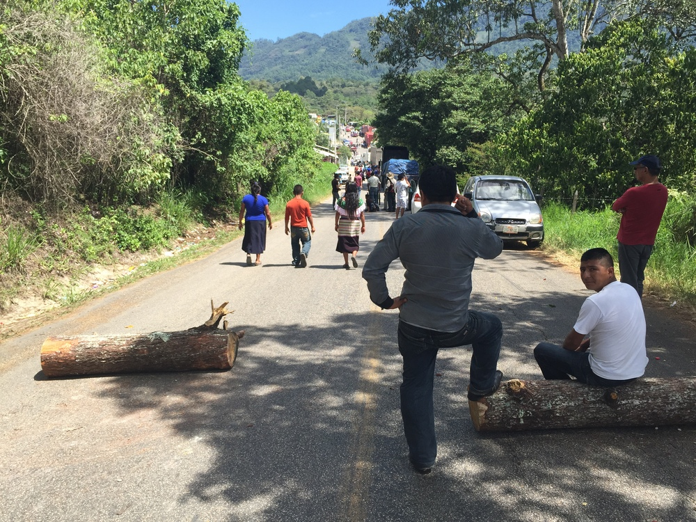 The first of three roadblocks between Palenque and San Cristóbal de las Casas. The logs don't look like much, but the roadblock lasts for a mile or two, congested with more serious albeit makeshift blockades.