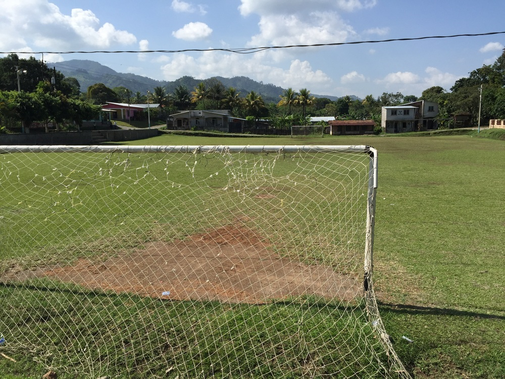 Fútbol field in Honduras. Find the Pepsi logo.