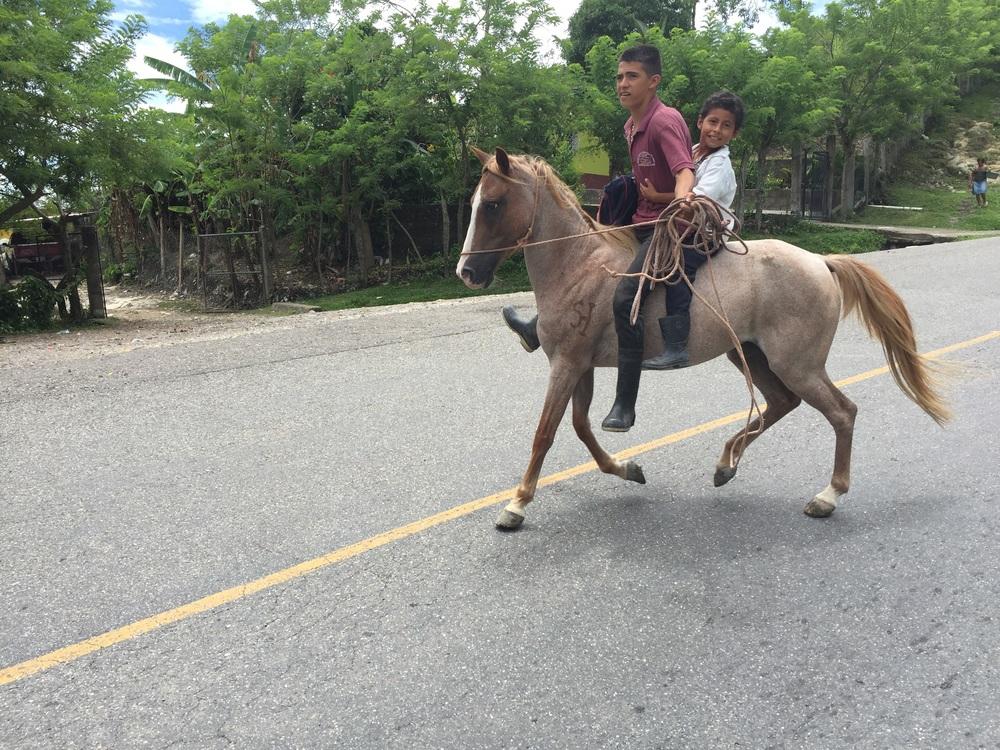Two boys and a schoolbag in San Antonio, Honduras.