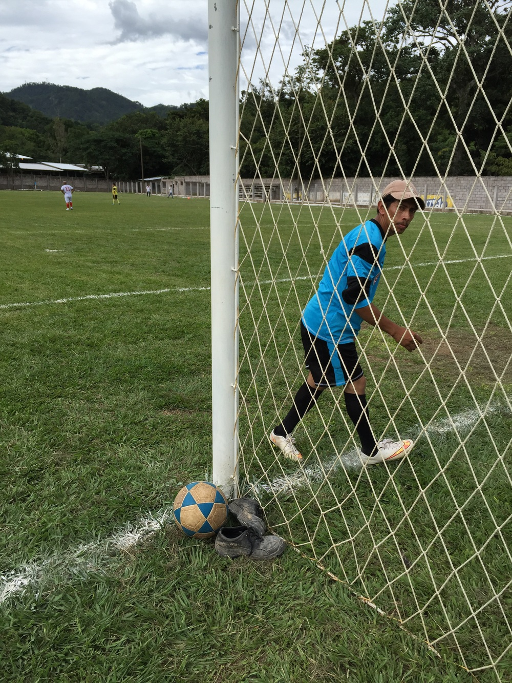 Over-forty fútbol in Copán Ruinas, Honduras. This shorter catracho got worked over for at least three goals in the first half, just can't reach the top of the goalpost.