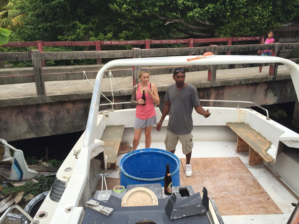 Moncho gives Holly the rundown on his restoration project. This boat is slated for Roatán.