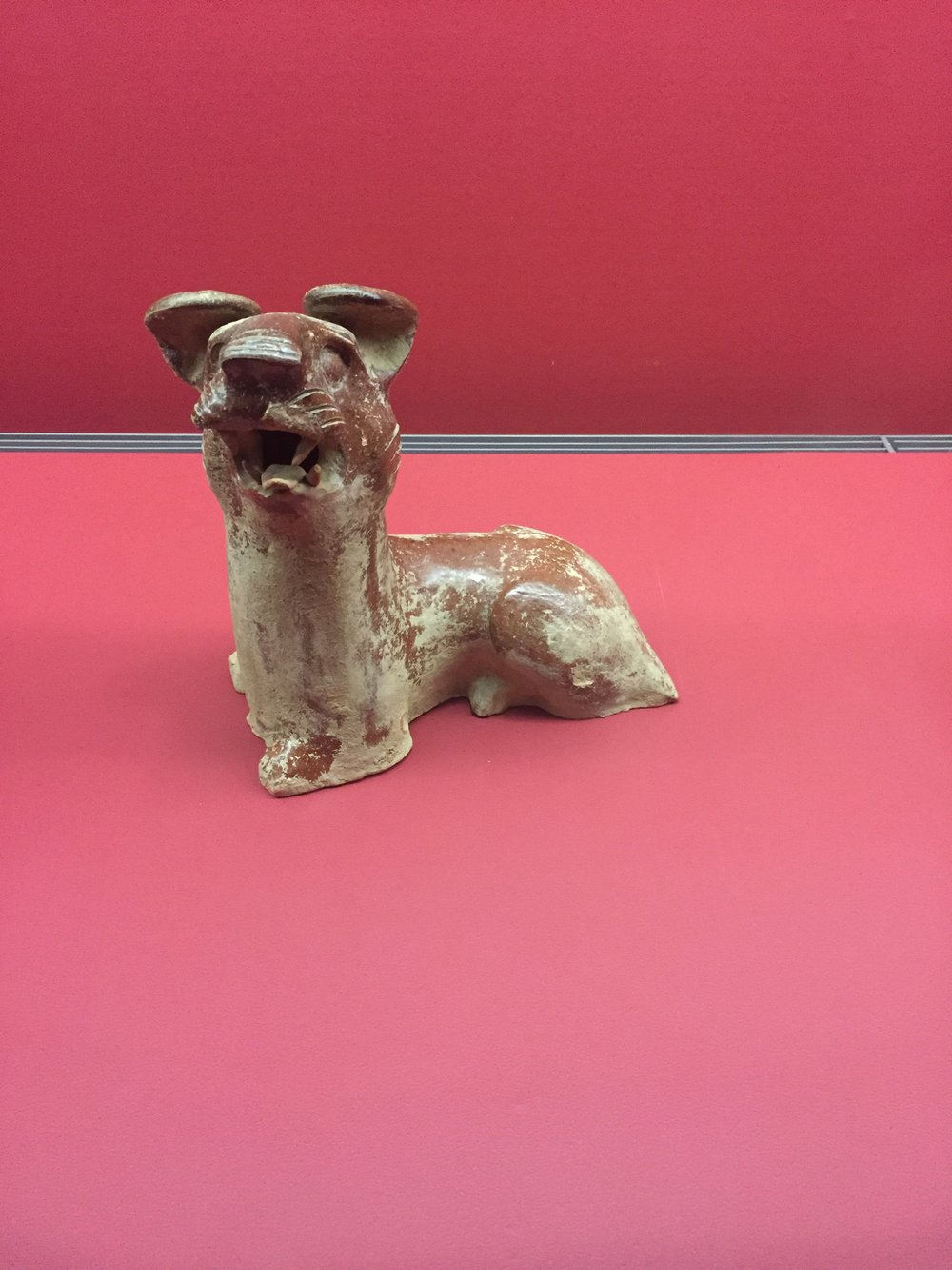 Glazed pottery from the Han dynasty (206 BCE to 220 CE). Yeah, that's a dog.