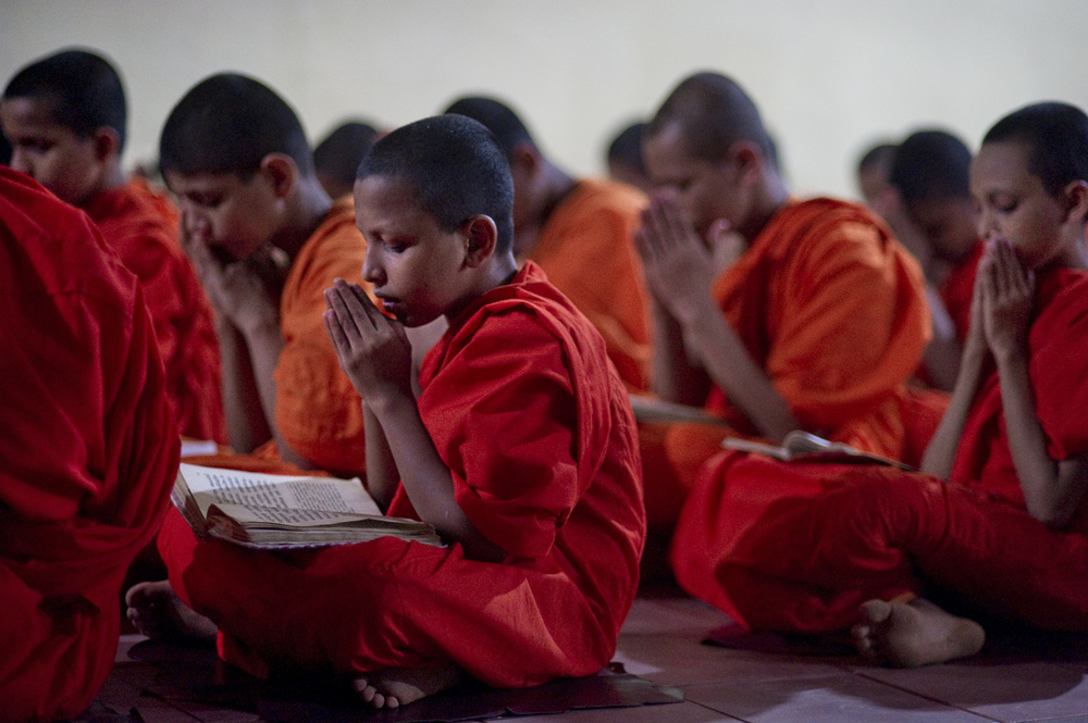 Young monks meditate in an evening session in a Astgiriya monastery in Kandy. The youngest monk is 9 years old.