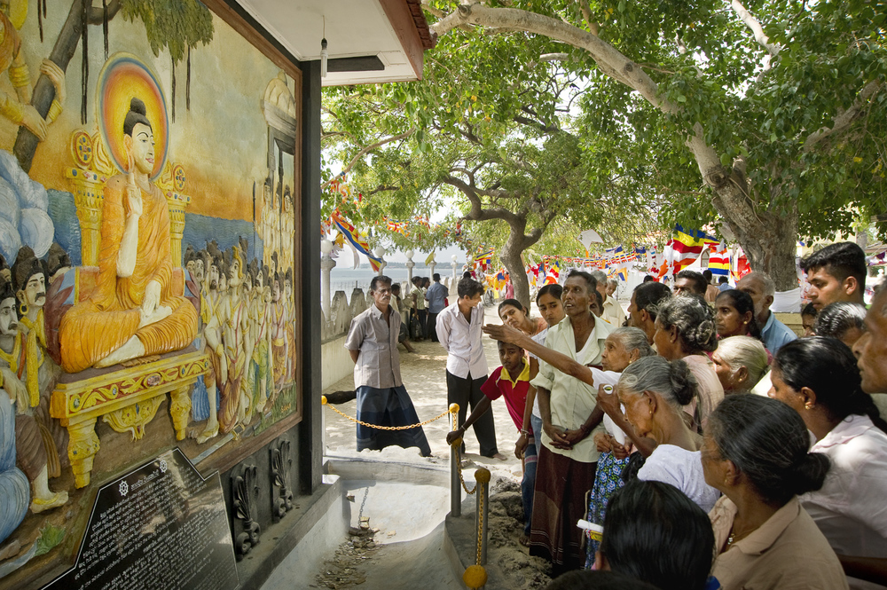 Pilgrims visiting Nagadeepa, an island north of Jaffna in the Palk strait, said to be Buddha's first landing point on the way to Sri Lanka. As the island was off-limits for much of the civil war, many of the older pilgrims are visiting for the first time in 20-30 years.