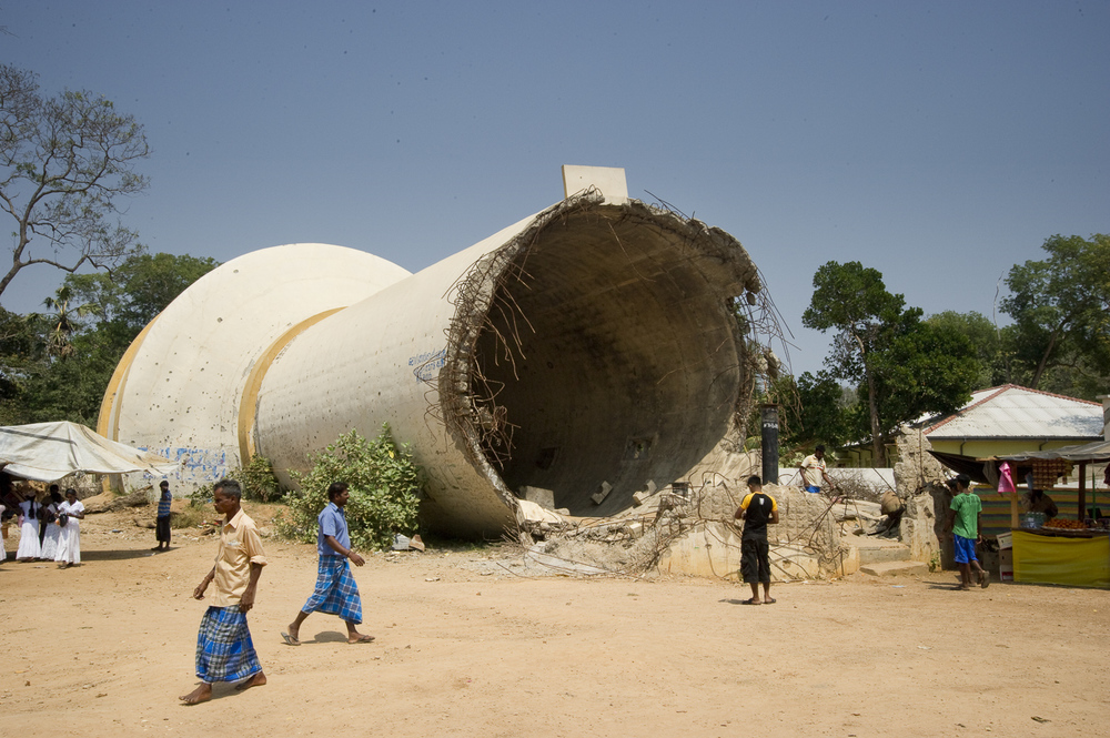 A toppled water tower in downtown Kilinochchi, once the Tamil Tigers administrative center. The Sri Lankan army and the Tigers accuse each other of destroying the tower.