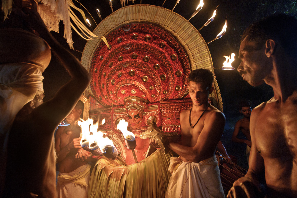"A theyyam performance of Muchilottu Bhagavati, the Mother Goddess, near Cheruvathur, Kerala, India. Theyyam"" (a rendering of the Sanskrit word for ""God"") is a North Kerala rite or art form that dates back thousands of years."