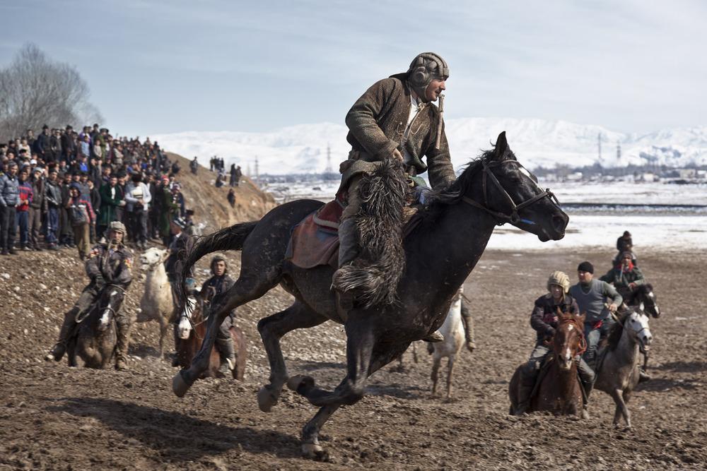 A buzkashi rider breaks free of the pack in a weekend match near Dushanbe, Tajikistan.