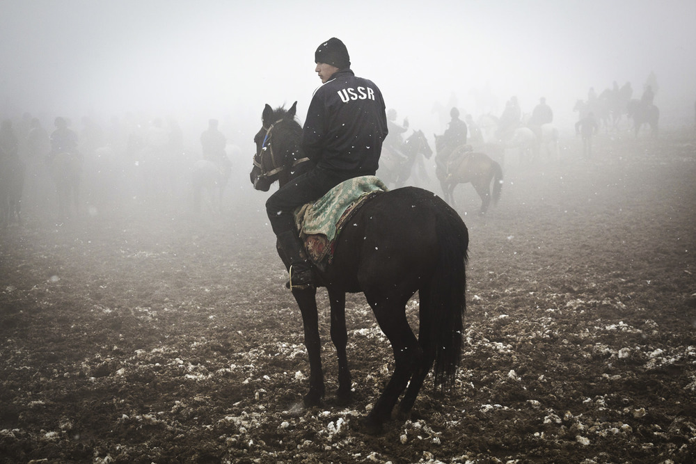 A buzkashi rider takes a break in the fog.