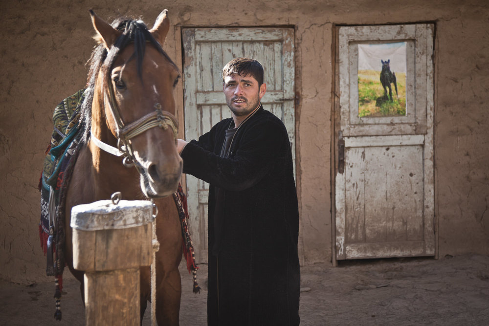 Khurshed prepares his horse for daily exercises in the mountains near his home in Dushanbe, Tajikistan's capital.