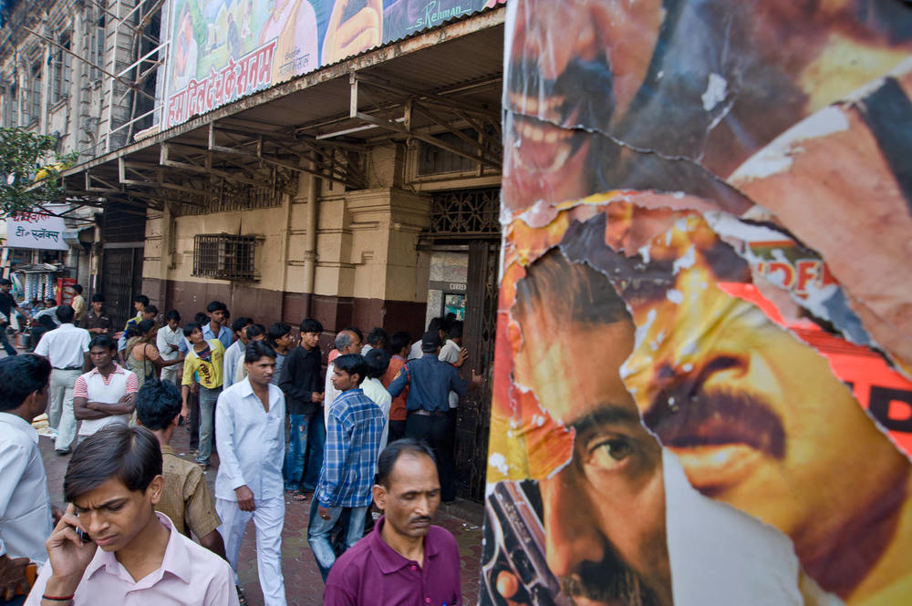Outside Alfred Talkies, one of Mumbai's oldest cinemas, dating to the silent period. The cinema is also one of the last in Mumbai to still carry hand-painted billboards.