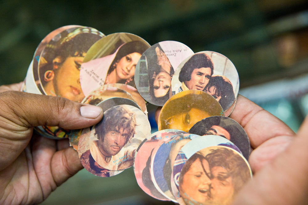 Ice cream cup tops featuring Bollywood film stars from the Mansoori family collection.