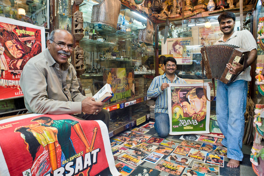 The Mansoori family in 'Mini Market,' one of three Bollywood memorabilia family-run shops in Mumbai's Chor Bazaar (Thieves' market). Sporting one of India's largest collections of posters, trinkets, original poster paintings (first runs, from which prints were made), props and costumes, the shop caters to private collectors, fans, even costume directors and set designers from Bollywood films looking for a 'period feel.'
