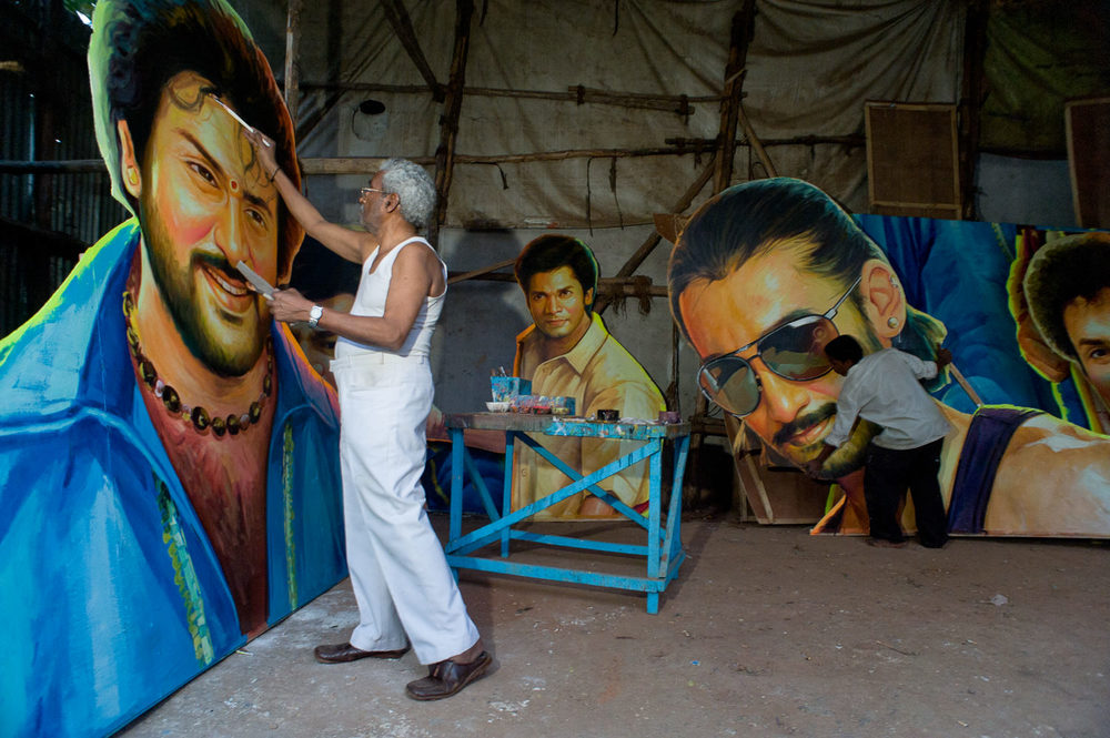 A practice largely discarded in Northern India, superscale handpainted film-hero 'cut-outs' still grace the entrance of cinema halls throughout South India (Andhra Pradesh, Karnataka, Tamil Nadu). While cinemas grow less receptive to supporting such production costs, poster/cut-out painters are finding similarly grandiose work with politicians and political campaigns, which sometimes are run by ex-actors and ex-actresses.