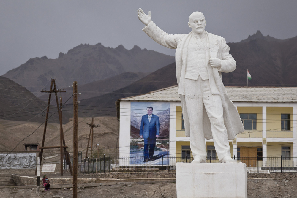 A building-size portrait of Tajik president Emomali Rahmon is dwarfed by a Soviet-era statue of Lenin in the eastern outpost of Murghab, in Tajikistan.