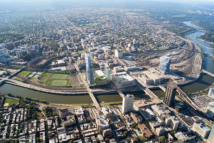Aerial image of 30th Street Station District with renderings of FMC, EVO, and Cira Centre towers by Brandywine.