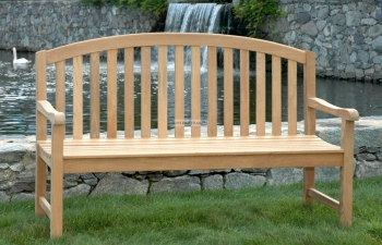 """Teak Bench  A teak bench with a graceful arched back. We will place twelve around the pond to provide placesof rest, relaxation and contemplation of the pondwith its fountain center piece. Teak wood isnaturally beautiful and weather resistant. The treesare grown in plantations and sustainably harvested. To insure permanence, we will secure the bench toa concrete foundation. The bench is of commercial gradeand 5 feet long. The arch is a single piece of teak, notmade of multiple jointed pieces. $1200 You may request that a heavy bronze plaque beattached to the bench honoring or memorializingsomeone you care for. Size of the plaque is 2""""x 8"""". See form below to order text"""