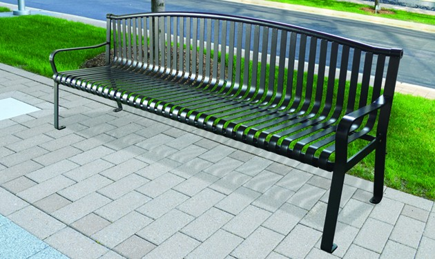 """Metal Bench  A metal bench in a classic park style. Constructed of powder coated steel for strength and weather resistance. We will place eight of these along natural trails in the more wooded sections of the park. Like the teak bench, they will be secured to a concrete foundation with the option of adding a bronze plaque. The bench is 6 feet long. $1200 It includes a bronze plaque, 2"""" x 8"""" wide with text of your choice. See form below."""