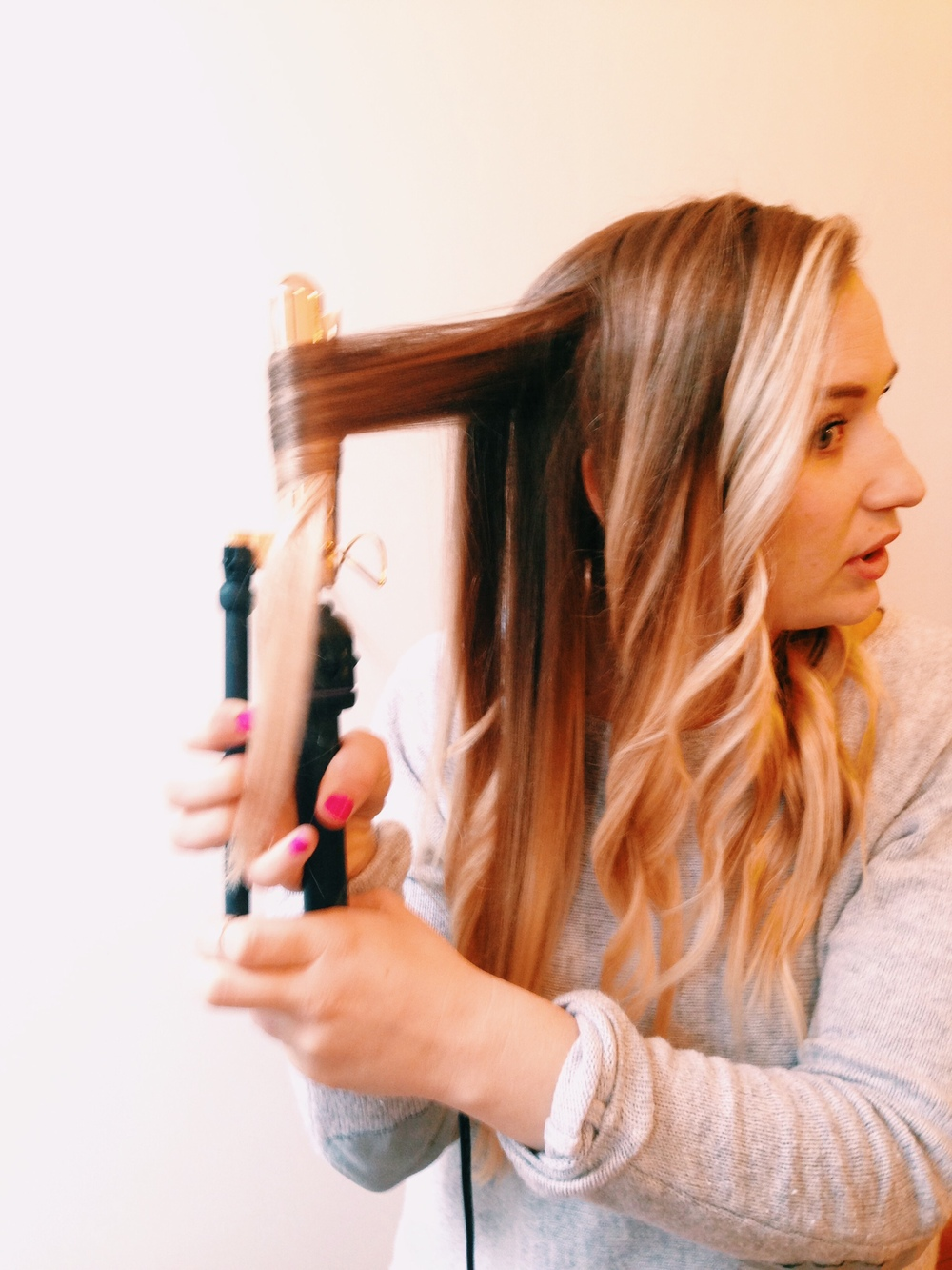 "Begin curling hair with 2"", vertical sections curling back away from face."