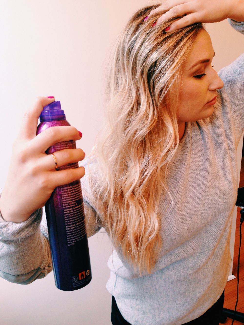Set curls with a light holding spray.