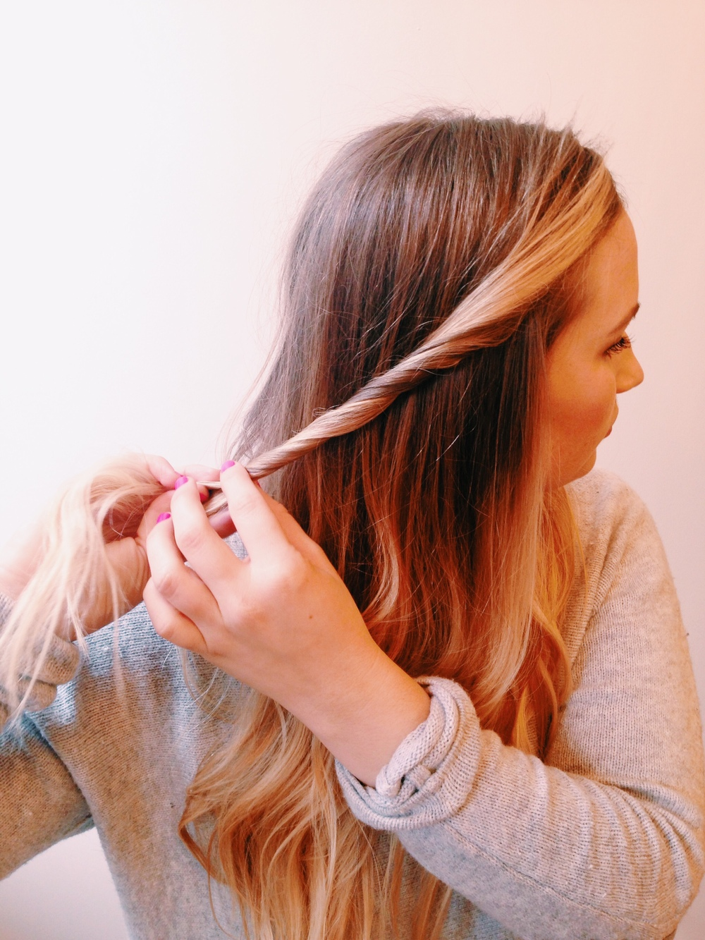 Beginning on one side, gather desired amount of hair and begin twisting.