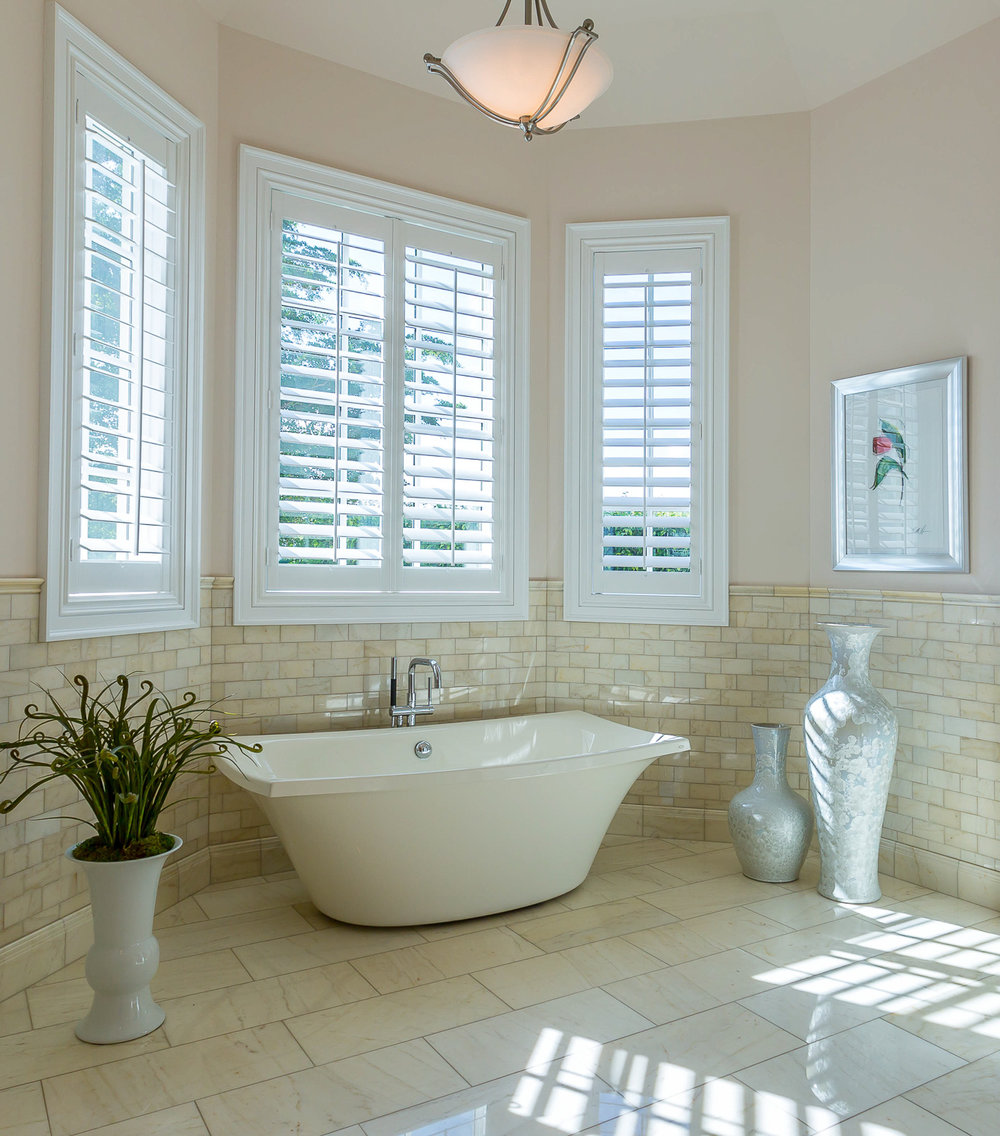 Soaker tub located in owner's suite Home Stories Photography