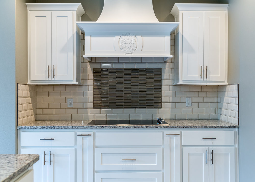 Real Estate photo of kitchen and custom hood in home located in